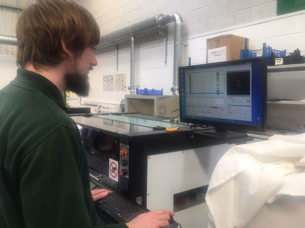 A Squared Technologies Tom working on component machine